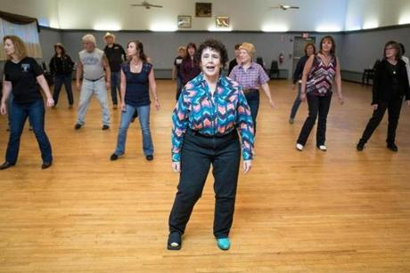 Country western dancing instructor Julie Kaufmann of Medford leads a group during an afternoon session at the Moose Lodge in North Reading.